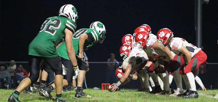 Waterford Wildcats and Trimble Tomcats stand at the line of scrimmage