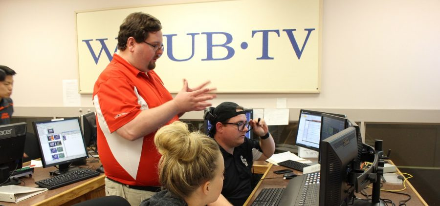 Jonathan Palmer working with students in control room