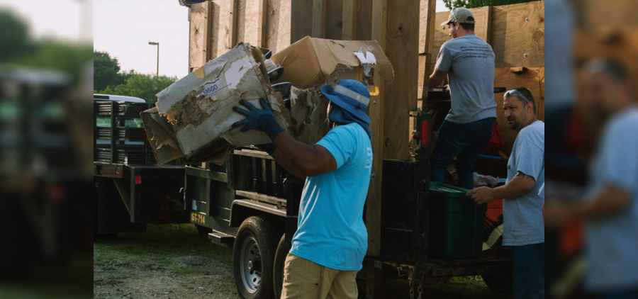 Participants in the nonprofit organization Truly Reaching You Inc. work at a job site in Akron. The nonprofit provides employment training and housing to formerly incarcerated men.