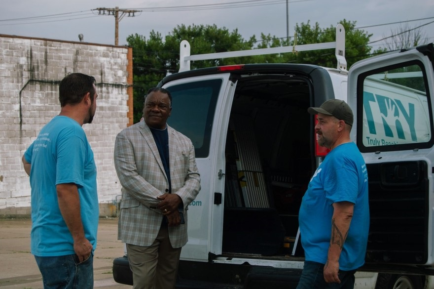 Perry Clark (center) runs the nonprofit Truly Reaching You (TRY) Inc. that provides employment training and housing to formerly incarcerated men. Clark says that arbitrary collateral sanctions are barriers for men returning from prison and increase recidivism.