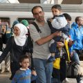 Refugees from Afghanistan, Syrian and Balkan Countries board a train in Munich, Germany.