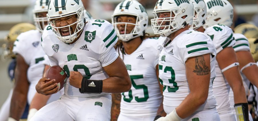 Armani Rogers, left, of the Ohio University Bobcats, celebrates after a touchdown in the Bobcats' 34-17 win over the University of Akron Zips, in Akron, Ohio, on Saturday, Oct. 2, 2021. [Joseph Scheller | WOUB]