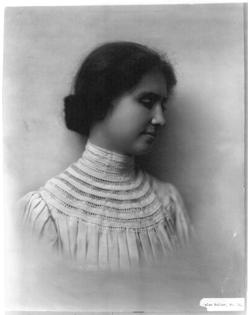 Black and white portrait of Helen Keller from the chest up