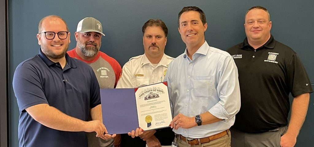 Secretary of State Frank LaRose presents a proclamation to representatives of Nelsonville accepting their enumeration numbers
