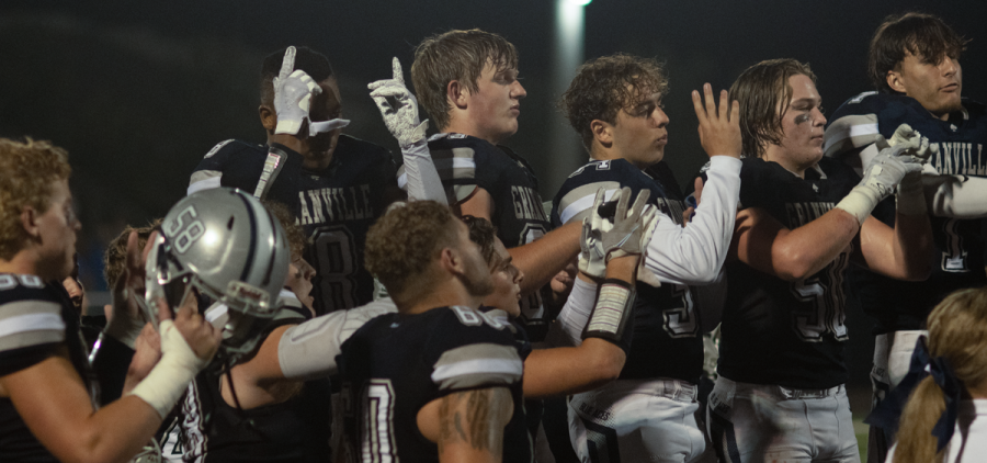 Group of Granville players raising their hands up