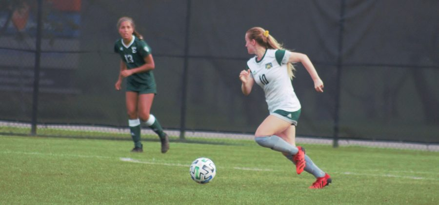 Ohio's Haley Miller (10) dribbles the ball towards the goal in the Bobcats' match with Eastern Michigan on Thursday, Oct. 21, 2021 at Chessa Field. [Payton Brooker   WOUB]