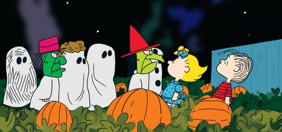 Linus & Lucy in pumpkin patch with kids dressed as ghosts for Halloween