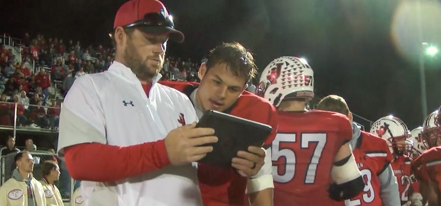 Jackson assistant coach shows Quarterback Jacob Winters film from the previous drives
