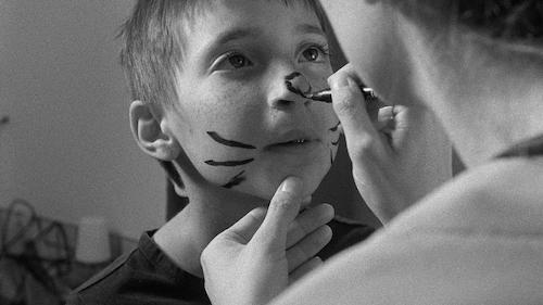 boy getting face painted