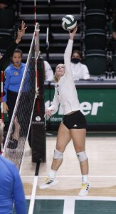 Tria McLean spikes the ball at a match against Eastern Michigan on October 8, 2021.