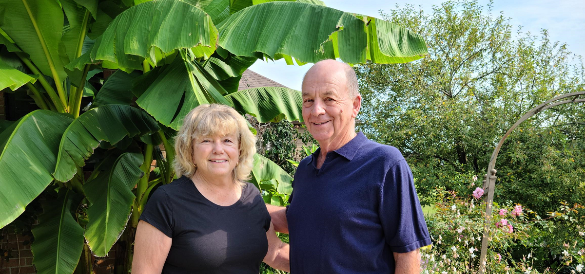 Neal and Barbara Caldwell in front of their garden