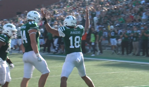 Ohio's Armani Rogers signals for a touchdown during his touchdown-scoring run in the third quarter of the Bobcats' game against Central Michigan.