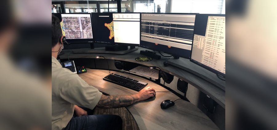 A dispatcher at the Montgomery Regional Dispatch Center answers 911 calls and enters information into a Computer-Aided Dispatch System.