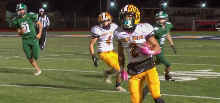 Berne Union player breaks away from Fisher Catholic defense and runs downfield