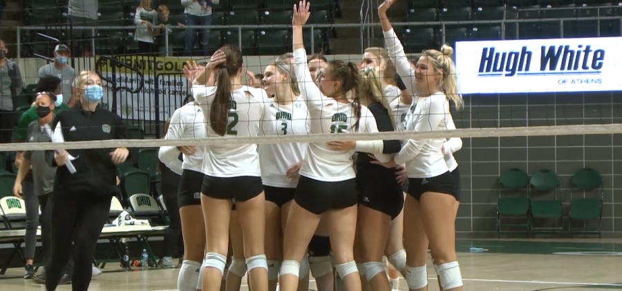 Members of the Ohio volleyball team celebrate on the court following the match point over Kent State on Oct. 20, 2021.