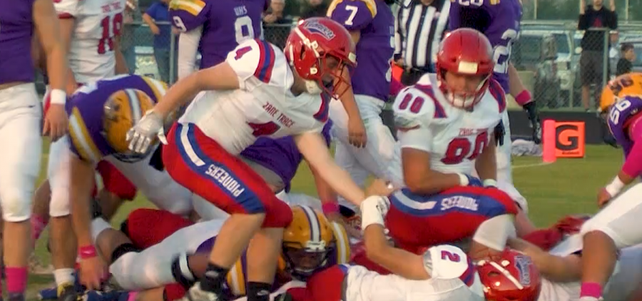 Zane Trace player extends a hand to help his teammate stand up