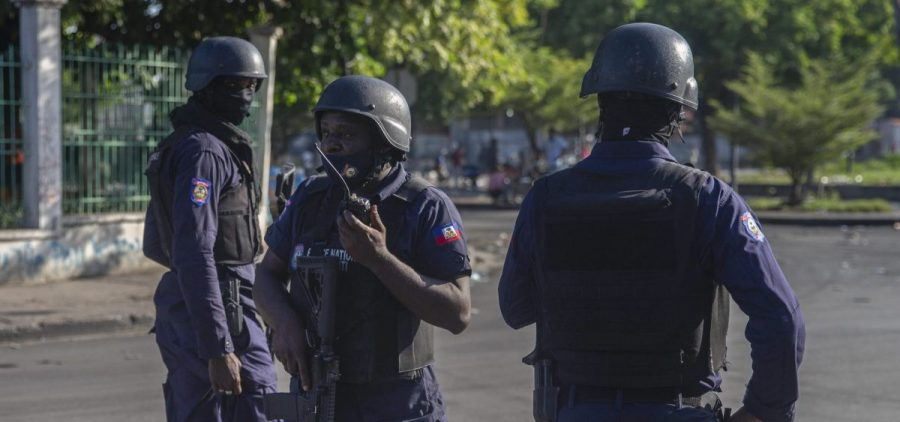 Armed forces secure the area where Haiti's prime minister, Ariel Henry, placed a bouquet of flowers in front of a memorial to independence hero Jean-Jacques