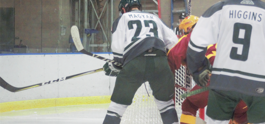 Drew Magyar (23) battles for a loose puck around the net as Ryan Higgins (9) cames in to help.in Iowa State on Friday, Oct. 15, 2021. [Jensen Knecht | WOUB]